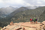 Caucasian mountaineers at an overlook, while hiking the Flattop Mountain Trail in Rocky Mountain National Park, west of Estes Park, Colorado.