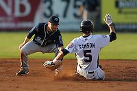 The Mobile BayBears shortstop Taylor Harbin #5 applies the tag on a hard sliding Nate Sampson during  game four of the Southern League Championship Series between the Mobile Bay Bears and the Tennessee Smokies at Smokies Park on September 18, 2011 in Kodak, Tennessee.  The BayBears won the Southern League Championship 6-4.  (Tony Farlow/Four Seam Images)