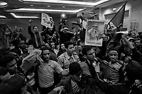 Tripoli, Libya, March 17, 2011.As the UN Security Concil votes a strong resolution against Libya, a press conference by the Libyan Deputy Minister of Foreign Affairs to the foreign press in a Tripoli hotel is interrupted by a 'spontaneous' irruption of about 50 young Khaddafi supporters..