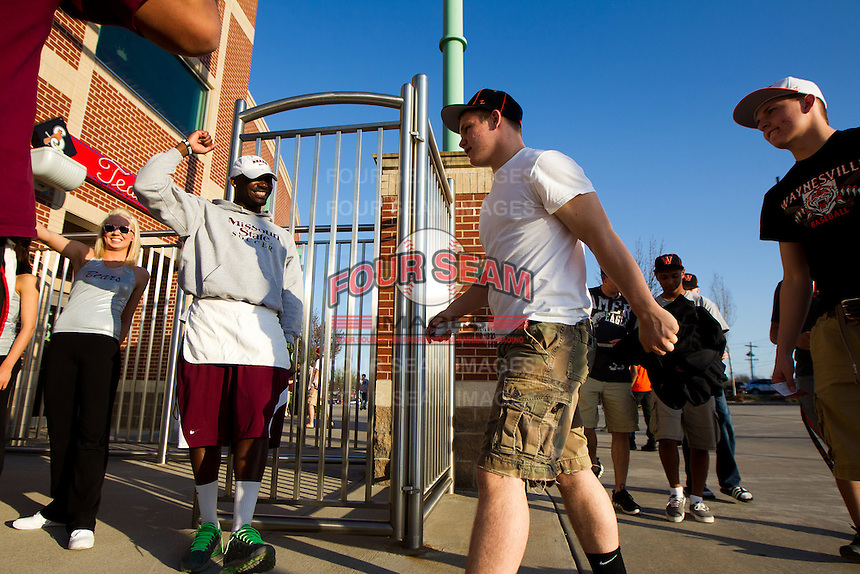 Fans enter the gate of Hammons Field prior to a game between the Purdue Boilermakers and the Missouri State Bears on March 13, 2012 in Springfield, Missouri. (David Welker / Four Seam Images)..