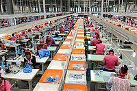 ETHIOPIA , Southern Nations, Hawassa or Awasa, Hawassa Industrial Park, chinese-built for the ethiopian government to attract foreign investors with low rent and tax free to establish a textile industry and create thousands of new jobs, taiwanese company Everest Textile Co. Ltd.produces textiles from synthetic fabric for export, production line / AETHIOPIEN, Hawassa, Industriepark, gebaut durch chinesische Firmen fuer die ethiopische Regierung um die Hallen fuer Textilbetriebe von Investoren zu vermieten, taiwanesische Firma Everest Textile Co. Ltd. produziert Textilien aus synthetischen Stoffen fuer den Export