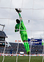 DENVER, CO - JUNE 19: Loic Chauvet #1 tips the ball over the goal during a game between Martinique and Cuba at Broncos Stadium on June 19, 2019 in Denver, Colorado.