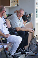 Charlotte Knights trainer Scott Johnson chats with hitting coach Andy Tomberlin (11) during the game against the Indianapolis Indians at BB&T BallPark on June 21, 2015 in Charlotte, North Carolina.  The Knights defeated the Indians 13-1.  (Brian Westerholt/Four Seam Images)