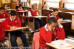 K-8 Parochial School Bronx New York Grade 4 children seated in rows reading along from handout horizontal