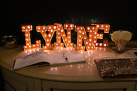 Party photography isn't complete without features like this guest book, gifts and sign.