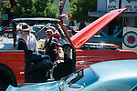 Casey Collins and Tammy Latimer look at classic vehicles during Legends of the West in Carson City, Nev., on Saturday June 22, 2013.<br /> (Photo by Kevin Clifford/Nevada Photo Source)