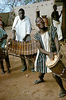 Musicians of Bobo tribe playing drums and balafon xylophone in Koumbia, Burkina Faso, Africa..