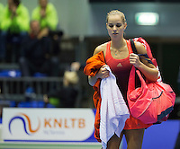 Rotterdam, Netherlands, December 19, 2015,  Topsport Centrum, Lotto NK Tennis, Arantxa Rus (NED) leaves the court<br /> Photo: Tennisimages/Henk Koster