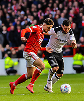 Nottingham Forest's midfielder Matty Cash (14) and Derby County's midfielder Bradley Johnson (15) challenge in midfield during the Sky Bet Championship match between Nottingham Forest and Derby County at the City Ground, Nottingham, England on 10 March 2018. Photo by Stephen Buckley / PRiME Media Images.