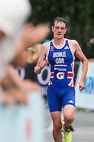 24 JUN 2012 - KITZBUEHEL, AUT - The crowd applaud Alistair Brownlee (GBR) of Great Britain during the run at the elite men's 2012 World Triathlon Series round in Schwarzsee, Kitzbuehel, Austria (PHOTO (C) 2012 NIGEL FARROW)