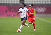 KASHIMA, JAPAN - AUGUST 2: Crystal Dunn #2 of the United States dribbles the ball during a game between Canada and USWNT at Kashima Soccer Stadium on August 2, 2021 in Kashima, Japan.