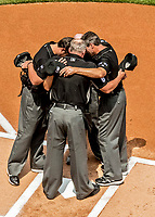 30 April 2017: The four MLB game  umpires huddle at home plate prior to the start of play between the Washington Nationals and the New York Mets at Nationals Park in Washington, DC. The Nationals defeated the Mets 23-5 as the Nationals set several individual and team records in the third game of their weekend series. Mandatory Credit: Ed Wolfstein Photo *** RAW (NEF) Image File Available ***