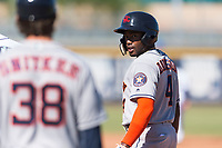 Scottsdale Scorpions center fielder Ronnie Dawson (4) and hitting coach Troy Snitker (38), both of the Houston Astros organization, talk during an Arizona Fall League game against the Peoria Javelinas at Peoria Sports Complex on October 18, 2018 in Peoria, Arizona. Scottsdale defeated Peoria 8-0. (Zachary Lucy/Four Seam Images)