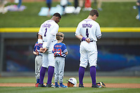 (L-R) Winston-Salem Dash shortstop Yeyson Yrizarri (2) and second baseman Mitch Roman (4) are joined on the field by youth baseball players for the National Anthem prior to the game against the Salem Red Sox at BB&T Ballpark on April 22, 2018 in Winston-Salem, North Carolina.  The Red Sox defeated the Dash 6-4 in 10 innings.  (Brian Westerholt/Four Seam Images)