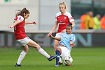 Nikita Parris of Manchester City Women and Louise Quinn of Arsenal Women and Lisa Evans of Arsenal Women