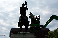 Workers clean the Andrew Jackson statue in Lafayette Square near the White House in Washington D.C., U.S., on Thursday, June 11, 2020.  Additional fencing that had been added around the White House due to protests over the death of George Floyd is slowly being removed.  Credit: Stefani Reynolds / CNP/AdMedia