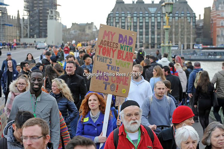 """Protestors cross Westminster Bridge at the end of  the """"Put it to the People"""" rally which made it's way through central London today. Demonstrators from across the country gathered to call for a second referendum on Brexit and to march through the UK capital finishing with speeches in Parliament Square opposite the Houses of Parliament in Westminster."""