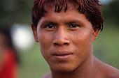 Xingu, Brazil. Posto Leonardo; Xinguano Indian with red Urucum hair colour.