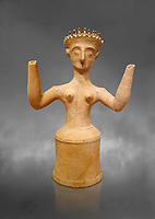 Minoan Postpalatial terracotta  goddess statue with raised arms, Kannia Sanctuary,  Gortys, 1350-1250 BC, Heraklion Archaeological Museum, grey background. <br /> <br /> The Goddesses are crowned with symbols of earth and sky in the shapes of snakes and birds, describing attributes of the goddess as protector of nature.