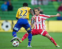 MELBOURNE, AUSTRALIA - OCTOBER 23: Adrian Zahara of the Heart tackles Adama Traore of Gold Coast during the A-League match between the Melbourne Heart and Gold Coast United at AAMI Park on October 23, 2010 in Melbourne, Australia. (Photo by Sydney Low / Asterisk Images)