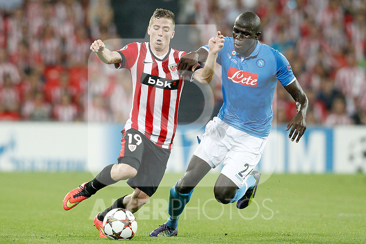 Athletic de Bilbao's Iker Muniain (l) and SSC Napoli's Kalidou Koulibaly during Champions League 2014/2015 Play-off 2nd leg match.August 27,2014. (ALTERPHOTOS/Acero)