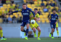 Central Coast Mariners' Gianni Stensness and Phoenix's Callum McCowatt (right) compete for the ball during the A-League football match between Wellington Phoenix and Central Coast Mariners at Westpac Stadium in Wellington, New Zealand on Saturday, 4 January 2020. Photo: Dave Lintott / lintottphoto.co.nz