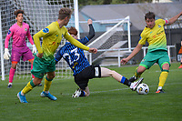 Kurtis Mogg clears under pressure from Owen Barnett (23) during the Central League football match between Miramar Rangers and Lower Hutt AFC at David Farrington Park in Wellington, New Zealand on Saturday, 10 April 2021. Photo: Dave Lintott / lintottphoto.co.nz