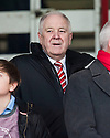 Craig brown takes his seat in the stand at Dens Park.