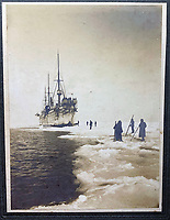 BNPS.co.uk (01202 558833)<br /> Pic: HAldridge/BNPS<br /> <br /> Also included are some of Smith's photographs of Mimia crew dealing with sea ice.<br /> <br /> A poignant cross made from drift wood from the Titanic by a seaman tasked with recovering the bodies from the disaster as surfaced 107 years later.<br /> <br /> The small religious symbol was delicately hand carved by Samuel Smith, a joiner on the cable-laying ship Minia which was tasked with searching for bodies.<br /> <br /> Mr Smith was so moved by the macabre experience that he honoured the victims by creating the wooden cross on a three-tiered plinth.<br /> <br /> He made it from a piece of oak wood he plucked from the ocean that has come from the sunken liner.<br /> <br /> The archive is estimated to sell for £35,000 at H Aldridge in Devizes.