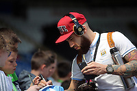Nicolas Otamendi of Manchester City (R) arrives during the Swansea City FC v Manchester City Premier League game at the Liberty Stadium, Swansea, Wales, UK, Sunday 15 May 2016