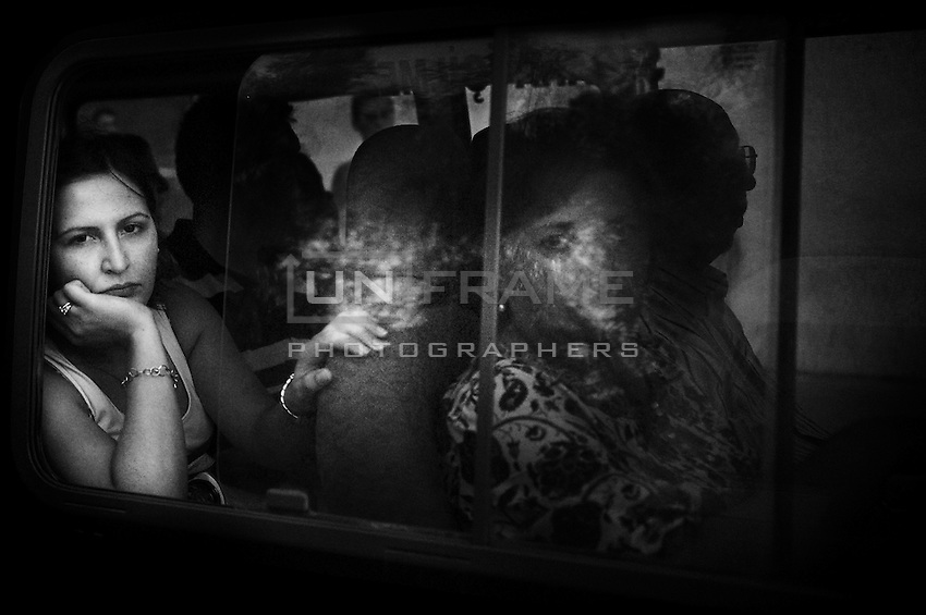 A woman waits in a bus in the occupied North of Cyprus