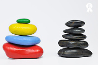 Stack of multi-colored and black pebbles, studio  (Licence this image exclusively with Getty: http://www.gettyimages.com/detail/96354154 )