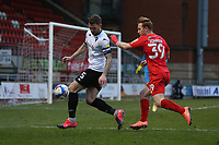 Ashley Eastham of Salford City and Danny Johnson of Leyton Orient during Leyton Orient vs Salford City, Sky Bet EFL League 2 Football at The Breyer Group Stadium on 2nd January 2021