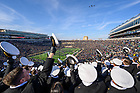 November 16, 2019; United States Naval Academy midshipmen cheer as a formation of F/A-18 Super Hornet and E/A-18 Growler aircraft fly over Notre Dame Stadium before the game against Navy. (Photo by Matt Cashore)