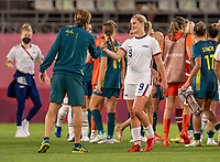 KASHIMA, JAPAN - JULY 27: Tony Gustavsson of Australia shakes hands with Lindsey Horan #9 of the USWNT after a game between Australia and USWNT at Ibaraki Kashima Stadium on July 27, 2021 in Kashima, Japan.
