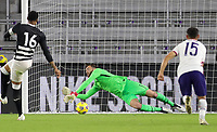 ORLANDO CITY, FL - JANUARY 31: Matt Turner #1 of the United States saves a PK during a game between Trinidad and Tobago and USMNT at Exploria stadium on January 31, 2021 in Orlando City, Florida.