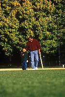 Father and son share quality time in the park.
