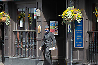 An optimist checks to see if Wetherspoons is open during the Coronavirus pandemic at Sidcup, Kent, England on 2 April 2020. Photo by Alan Stanford.
