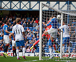 The header from Marius Zaliukas sneaks in under the bar for an equalising goal to Rangers