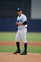 Tampa Tarpons starting pitcher Nick Green (12) gets ready to deliver a pitch during a game against the Clearwater Threshers on April 22, 2018 at George M. Steinbrenner Field in Tampa, Florida.  Tampa defeated Clearwater 2-1.  (Mike Janes/Four Seam Images)
