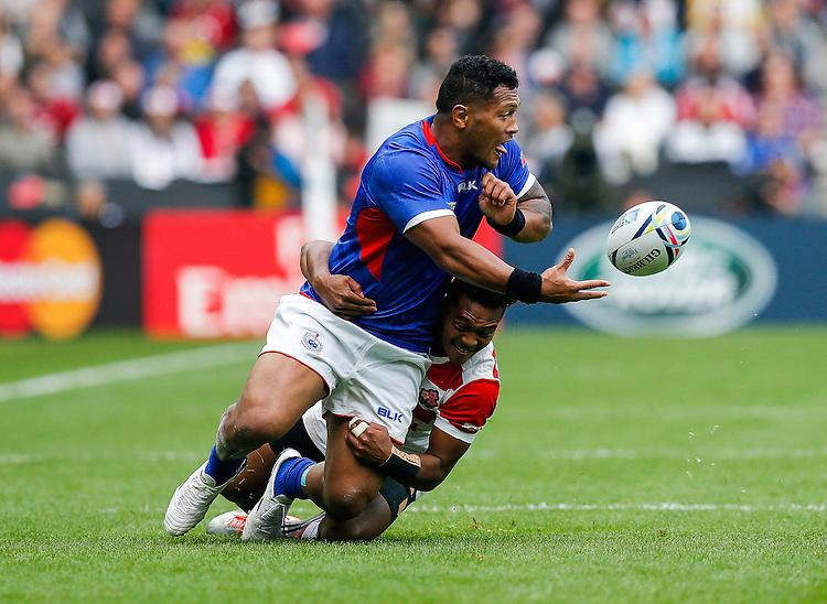 Samoa Inside Centre Johnny Leota is tackled by Japan Winger Kotaro Matsushima - Mandatory byline: Rogan Thomson - 03/10/2015 - RUGBY UNION - Stadium:mk - Milton Keynes, England - Samoa v Japan - Rugby World Cup 2015 Pool B.