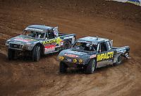 Mar. 19, 2011; Chandler, AZ, USA;  LOORRS pro lite driver Matt Loiodice right and Kyle Leduc in turn 3 during round one at Firebird International Raceway. Mandatory Credit: Mark J. Rebilas-US PRESSWIRE