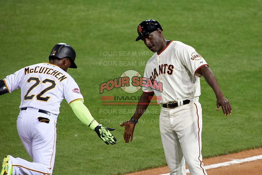 Pittsburgh Pirates Andrew McCutchen shakes hands with San Francisco Giants Roberto Kelly as he rounds the bases after hitting a home run during the MLB All-Star Game on July 14, 2015 at Great American Ball Park in Cincinnati, Ohio.  (Mike Janes/Four Seam Images)