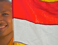 The Cambodian flag and Buddhist Monk at Wat Po Langkar, Monastery, Siem Reap Cambodia