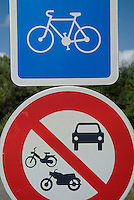 Bicycle and no vehicle sign on a bicycle track passing through the Landes Forest in Aquitaine, France.