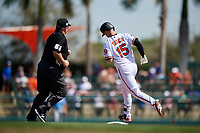 Baltimore Orioles catcher Chance Sisco (15) rounds second base after hitting a home run in the bottom of the second inning as umpire Marvin Hudson (51) looks on during a Grapefruit League Spring Training game against the Tampa Bay Rays on March 1, 2019 at Ed Smith Stadium in Sarasota, Florida.  Rays defeated the Orioles 10-5.  (Mike Janes/Four Seam Images)
