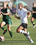 Lexi Weaver scores against Manogue in a 4-1 Douglas victory Tuesday afternoon, Sept. 20, 2011 in Gardnerville, Nev..Photo by Cathleen Allison