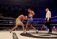 Felix Cash ( blue shorts) and Jay Byrne ( white/gold shorts) during their  Middleweight contest in the Matchroom Boxing JDNXTGEN Series event  at York Hall, Bethnal Green, England on 17 March 2017. Photo by Alan  Stanford.