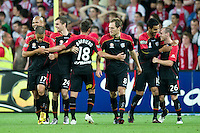 MELBOURNE, AUSTRALIA - NOVEMBER 19: Adelaide players celebrate Marcos Flores' goal during the round 15 A-League match between the Melbourne Heart and Adelaide United at AAMI Park on November 19, 2010 in Melbourne, Australia (Photo by Sydney Low / Asterisk Images)