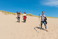 People Walking on Parabolic Dunes of Cape Cod